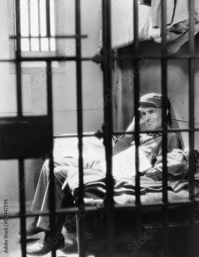 Fotografie, Obraz  Portrait of man in jail