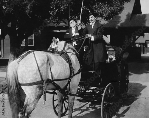 Gentlemen driving carriage with horse hitched backwards Canvas Print