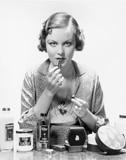 Woman applying cosmetics  - 104450180