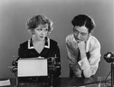 Two women with typewriter  - 104455324
