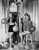 Women with balloons on New Years Eve  - 104455583