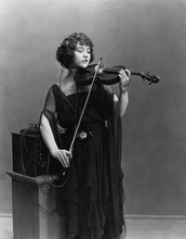 Woman Playing Violin With Head...