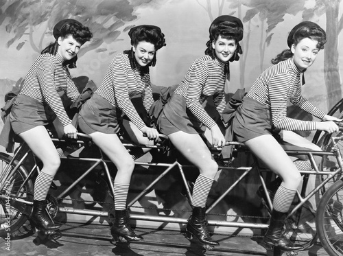 Obraz Four women on a bicycle  - fototapety do salonu