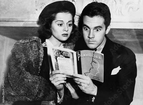 Fotografie, Obraz  Shocked couple reading together