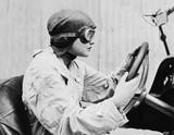 Portrait of female racecar driver  - 104459747
