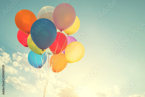 Photo  multicolor balloons with a retro instagram filter effect, concept of happy birth