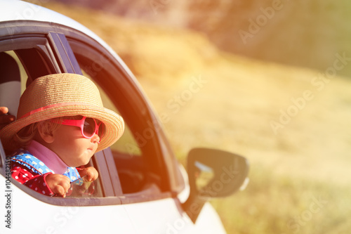 obraz dibond cute little girl travel by car in mountains