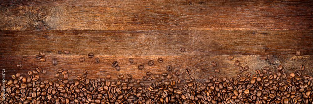 coffee background with beans on rustic old oak wood