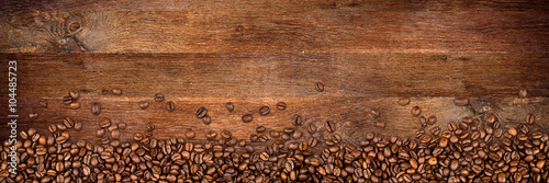 Obraz coffee background with beans on rustic old oak wood - fototapety do salonu