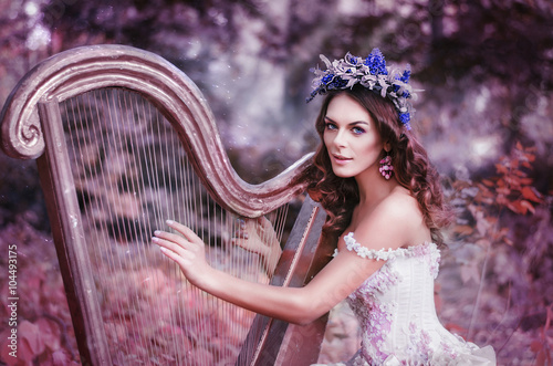Stampa su Tela beautiful brown-haired woman with a flower wreath on her head, wearing a white d