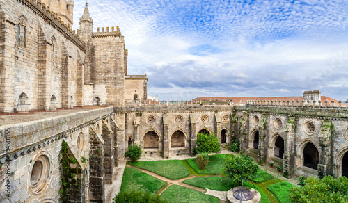 Poster Monument Cloister of the Evora Cathedral, the largest cathedral in Portugal. Romanesque and Gothic architecture. UNESCO World Heritage Site.