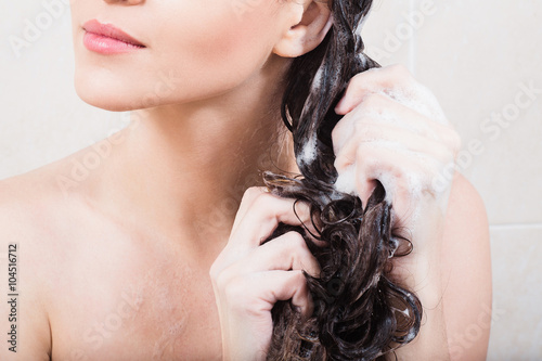 Fotografie, Obraz  Young woman washing hair with shampoo in the shower