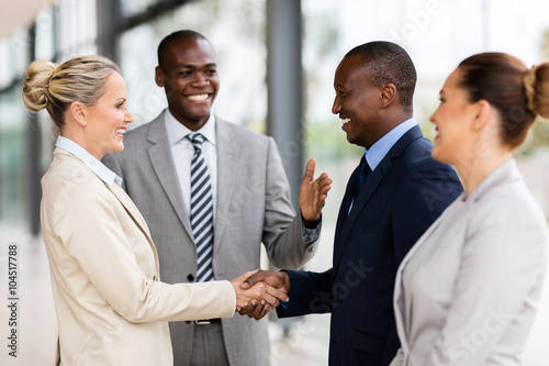 Fotografía  african man introducing businesswoman to business partners