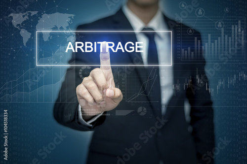Businessman hand touching ARBITRAGE   button on virtual screen Canvas Print