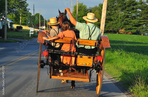 Stampa su Tela Lancaster County, Pennsylvania:  An Amish family riding along a country road in
