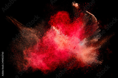 Fotografía Colorful Dust Particle Explosion Isolated on Black