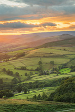 Beautiful Golden Glowing Sunlight Shining Down On British Green Countryside At Stanage Edge In The Peak District, UK.
