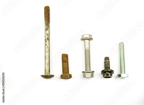 Close-up of various steel nuts and bolts  hardware - bolts, nuts