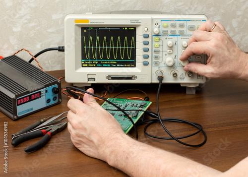 Fotografie, Obraz  Workplace engineer. Oscilloscope.