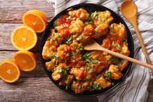 Orange Chicken In Sweet And Sour Sauce Close-up. Horizontal Top View