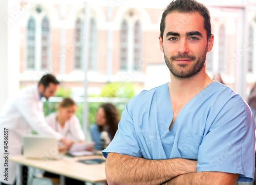 Portrait of a young attractive nurse at the hospital Wallpaper Mural