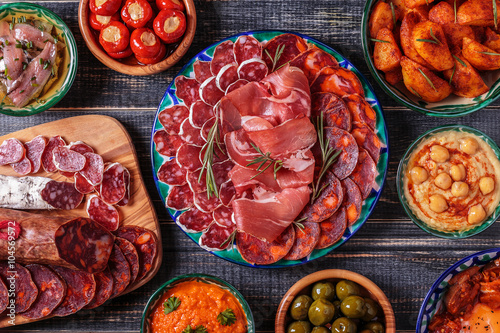 Fotografering  Typical spanish tapas concept, rustic style,  top view.