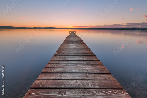 Old wooden pier on sunset