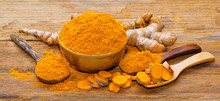 Fresh Turmeric Roots On Wooden...