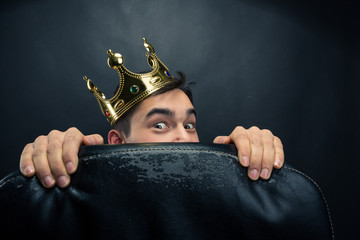 Scared man with crown