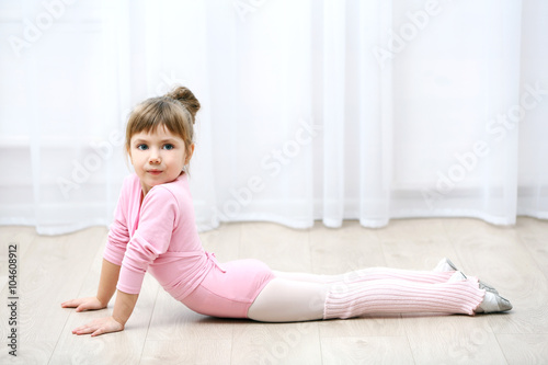 500bc9ccc651 Little cute girl in pink leotard making new ballet movement at dance ...