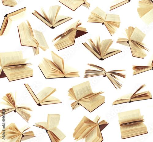 Stampa su Tela Many flying books as background isolated on white