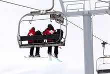 US Forest Medical Rescue Crew Riding Ski Lift
