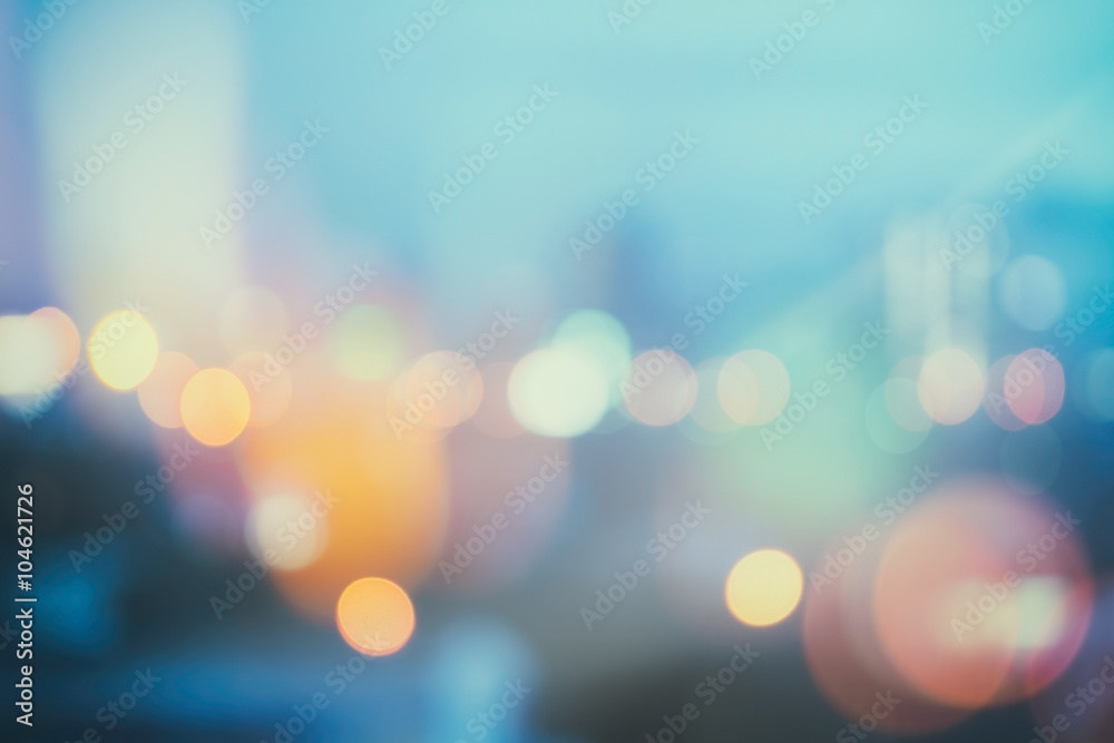 Fototapeta abstract background with bokeh defocused lights and shadow from cityscape at night, vintage or retro color tone