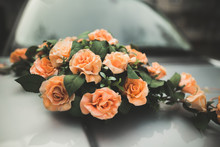 Pretty Good Wedding Bouquet Of Various Flowers On Car