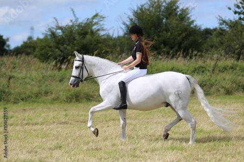 Girl riding andalusian grey horse bareback Canvas Print