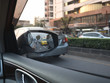 Car on-board driver looking outside to side mirror.