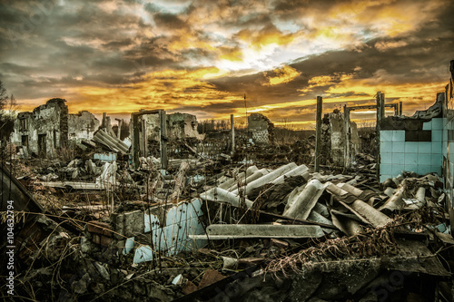 Fotografie, Obraz  Apocalyptic landscape.The remains of destroyed houses at sunset