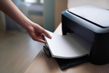Lay Down Or Take  Paper From  Printer