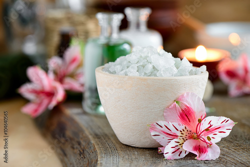 Spa setting decorated with purple flowers Poster