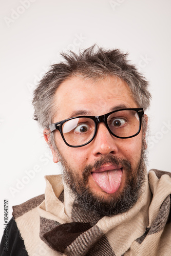 Crazy looking old man with grey beard with nerd big glasses show tongue rolling Canvas Print