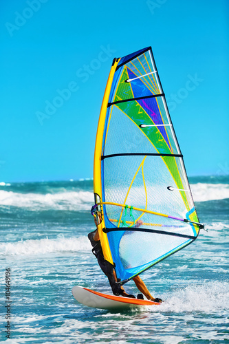 obraz lub plakat Recreational Water Sports. Windsurfing. Windsurfer Surfing The Wind On Waves In Ocean, Sea. Extreme Sport Action. Recreational Sporting Activity. Healthy Active Lifestyle. Summer Fun Adventure. Hobby