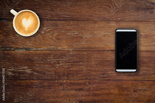 Spoed Foto op Canvas koffiebar Mobile phone and coffee cup on office wooden table