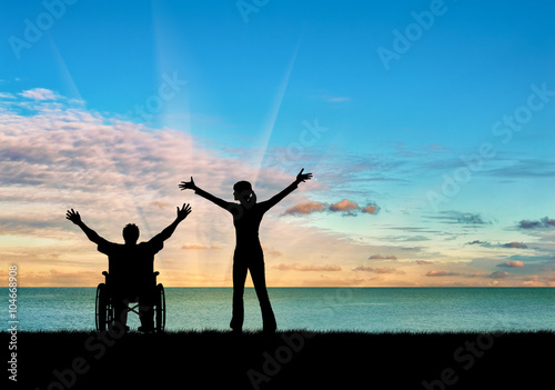 Silhouette happy disabled person and guardian Fototapeta