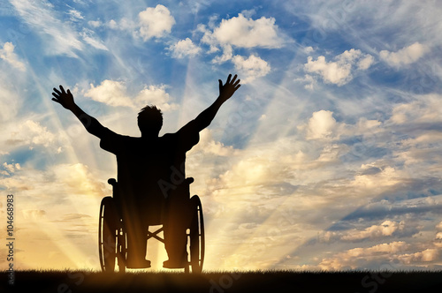Fotografie, Obraz  Silhouette happy disabled person