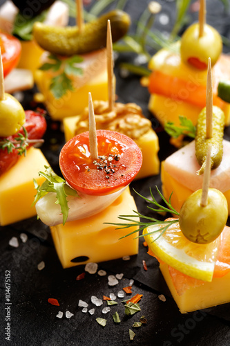 Fotografie, Obraz  Various cheese skewers  on a black background