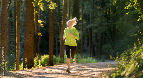 Poster Jogging Pretty young girl runner in the forest. Running woman. Female Runner Jogging during Outdoor Workout in a Nature. Beautiful fit Girl. Fitness model outdoors. Weight Loss. Healthy lifestyle.