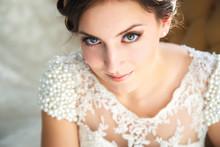 Beautiful Brunette Bride In A Luxurious Wedding Dress In Elegant Expensive Interior