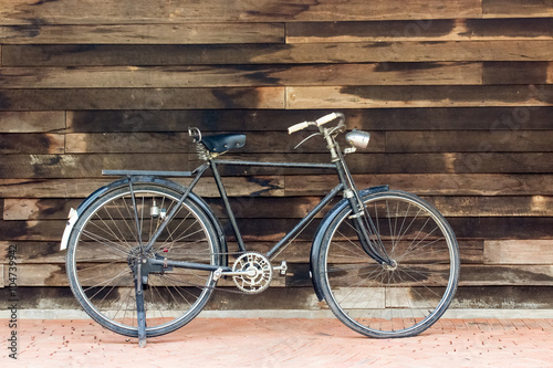 Aluminium Prints Bicycle Vintage rusted racing bicycle parked in an old factory with wood