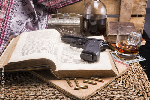 Fotografia  Set of ancient books , whiskey, casino dice and cards with handgun and bullets