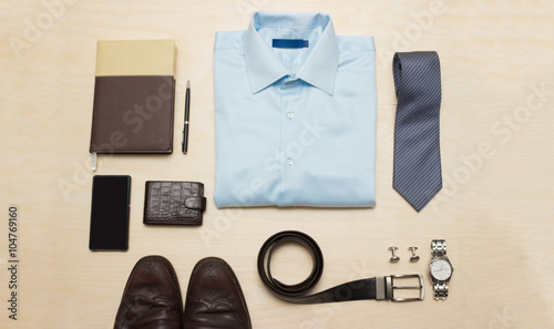 Obraz Men's classic outfit with blue shirt, tie and accessories - fototapety do salonu
